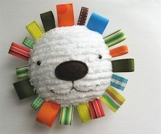 This is actually a great tag toy that you can make.  Babies are attracted to the bright colors and like to pull on the tags.