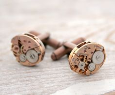 Steampunk Copper Cufflink  The perfect gift for the one you love. Yu will get super similar set.  Extraordinary pair of industrial cuff links  Perfect formal wear finish. Classic shirts with cuff holes are back in fashion!  Made of rare, original Swiss vintage watch movements (I suppose they are copper, but I am not 100% sure) These nice, tiny red stones are real rubies.  The watches do not work anymore, but nevertheless they are impressive.