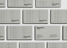 Architecture business card with grey board and black foil detail by Grosz Co. Lab for Ascui & Co.