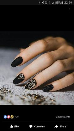 Black nails with gold accents: