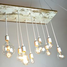The surf lodge nights chandelier by Urban Chandy - made from reclaimed barn wood and vintage-style Edison bulbs