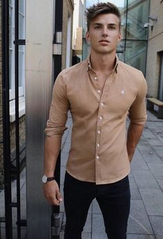 1f87c49752 Men Clothing Summer style inspiration with a beige button up shirt with  rolled up sleeves black denim black leather banded watch. Declan