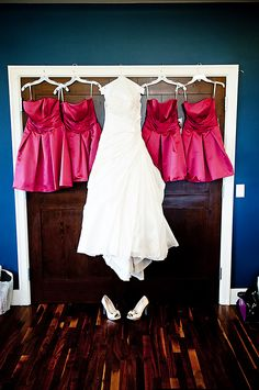You always see pictures of just the bride's gown, I like this of the gown with the bridesmaid's dresses!Love this idea!!
