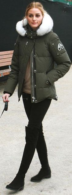 Who made  Olivia Palermo's black suede thigh high boots and green coat?