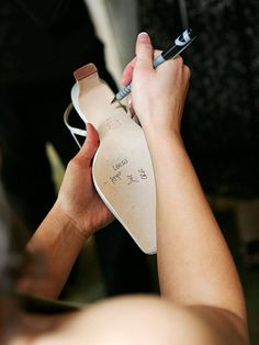 "I never knew this...""Bridesmaids sign the bottom of the brides shoes. Tradition says that whoever's name doesn't wear off by the end of the night is the next one to walk down the aisle."" cute idea"