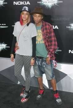 Pharrell Williams hit up the red carpet of the 'Dark Knight Rises' premiere in New York last night with his baby's mother/fiancee Helen Lasichanh. And they were such a coordinating couple with Pharrell in his Chanel Lumberjack boots and Billionaire Boys Club Stenciled Washed Jeans while his girl rocked out in polka dot leggings and British Flag Doc Martens.