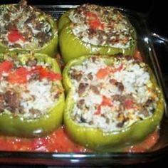 Green bell peppers stuffed with ground beef, rice, and sharp Cheddar cheese are a hearty meal perfect for weeknight dinners.