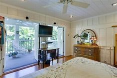 Between Naps on the Porch | A Tropical Cottage in Coconut Grove | http://betweennapsontheporch.net French doors onto screened porch - LOVE