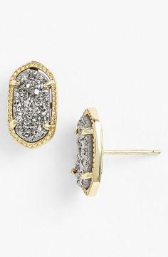 Glitzy Kendra Scott earrings.