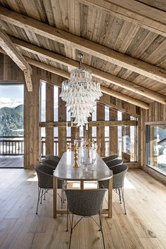 A Murano chandelier from Stéphane Olivier hangs above a marble-topped table by Bleu Nature in the dining room of the Rothschild's French ski chalet. Chalet Design, House Design, Chalet Interior, Elle Decor, Rustic Design, Rustic Decor, Rustic Style, Modern Rustic, Chalet Modern