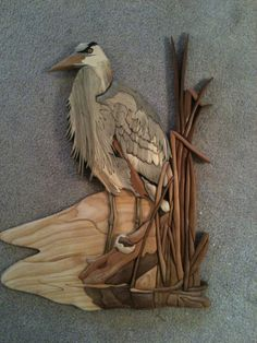 Great Blue Heron made of Western Red Cedar, Blue Pine, Aspen, Clear Pine, Spalted Maple, Walnut, Yellowheart and ebonized Mahogany.  Design by Bruce Worthington