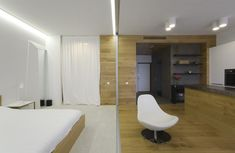 White Colored Floor Carpet Along With Bright Clear Corner Lamp