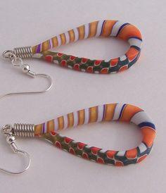Lizard Tail earrings by Jan Montarsi (Mr.)