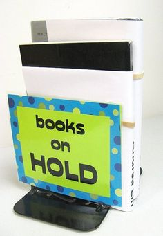 covers over metal bookends - this is one of many great display ideas for the library on this Flickr stream