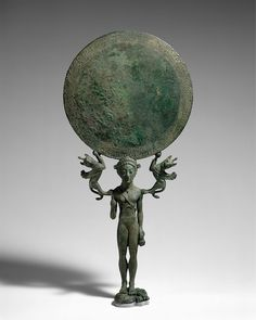 Bronze mirror with a support in the form of a nude girl | Greek, Laconian | Archaic | The Met