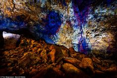 Splash of colour: The blue, orange and purple hues on the walls are a reaction to the monstrous heat as molten rock burst through the planet's crust Purple Hues, Orange And Purple, Mother Earth, Mother Nature, Volcano Iceland, Orange Walls, Volcanoes, Uk News, Vacation Destinations