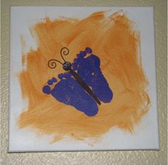 "We did this - i didn't do the painting in the background first but it still ended up really cute. I might re-do it on black paper with red feet and a white body to match my ""decor"" and hang it in with all their pictures in the front room. If you are doing multiple kids- be sure to label!"