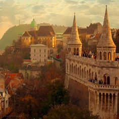 Budapest, Hungary ... Fisherman's Bastion. Looks like a fairy palace from this angle.  The real palace is in the left rear, with the green cupola.