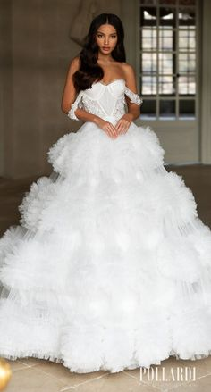 Dramatic Ball gown wedding dress with sweetheart neckline, off the shoulder strap and ruffled full skirt | Pollardi Wedding Dresses 2021 Royalty Bridal Collection - 3199_1 Royalty | How to Choose a Wedding Dress in 2021- Belle The Magazine | See more gorgeous bridal gowns by clicking on the photo