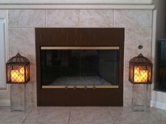 A DIY-two-fer! I updated the old matte black surround of my gas fireplace with more Aspect metal tiles! Easy to install and coordinates great with my kitchen backsplash we just DIY'd, as well!  Then, I repurposed two bronze candle holders (from a Southern Living phase!)..placed some new remote control battery powered candles and used square glass vases as the pillars! I plan to fill the vases with seasonal items to spice up my family room! Fall leaves, Christmas balls, even plastic easter…
