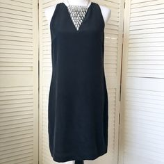 "Black sand-washed silk Cynthia Rowley shift dress Beautifully, perfectly simple. Off-black sand-washed 100% silk shift dress. Slightly fitted. Jewel neckline with keyhole back that closes with a loop and faceted clear crystal button. Sleeveless--cut back just a bit to show some shoulder. Knee length on me (I'm 5'7""). Fully lined. Very good quality. Looks gorgeous with a cropped jacket or cardigan. NWOT; tried on but never worn. Cynthia Rowley Dresses"