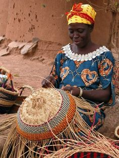 "Africa | ""Half way done"" Woman from the Bolgatanga area, making a Bolga basket.  Ghana 