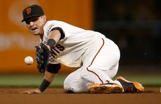 San Francisco Giants' Joe Panik (12) can't make a play on a ground ball against the San Diego Padres in the first inning at AT&T Park in San Francisco, Calif., on Thursday, Sept. 25, 2014.  (Nhat V. Meyer/Bay Area News Group)