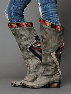 "Roadies Tall Boot | Distressed leather tall boot with woven blanket detailing around top and at back. Welted leather soles.   **Special Note: The distressing of the leather will vary resulting in a softer grey finish than pictured.  *By Freebird by Steven  *Leather Upper, Textile  *Goodyear Hand-Welted Leather Soles  *Made in Mexico  *16"" shaft height, 18"" opening circumference, 1 1/2"" heel height   **A Goodyear welted sole is a near-indestructible sole comprised of multiple layers of…"