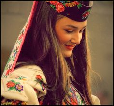 A woman in a traditional folk costume from Kosovo