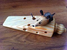 My little mouse cheese wedge door stop.
