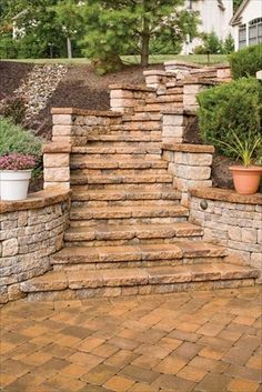EP Henry pavers used to create steps and eliminate slope in backyard landscape.