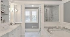 In cool gray and crisp white, this gorgeous master bathroom is both bright and soothing. The marble countertop, floor and bathtub surround compleme…   Pinteres…