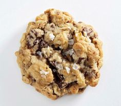 Salted Oatmeal Cookies With Dark Chocolate recipe: Chewy oats, a hint of cinnamon, and flaky sea salt on top give this chunky treat a sophisticated twist.