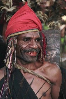 Leonardus Nyoman: a man with red head cover and his teeth and lips are also red cause of Bettel nuts. he is a leader of Lego-lego traditional dance which held in Takpala village Alor island