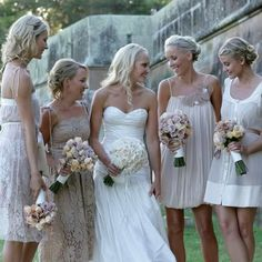 i love the dresses not matching....really like the short flowy dress on the right beside the bride....beach wedding dress perhaps?