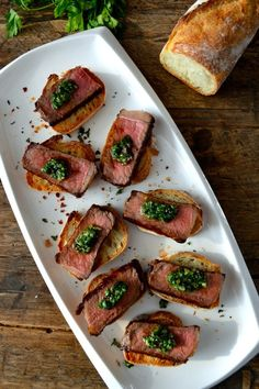 Pinchos, or pintxos, are a Spanish snack related to tapas, but usually served on bread and skewered with toothpicks to keep the toppings on the bread (and to keep track of how many one's eaten as the toothpicks pile up)