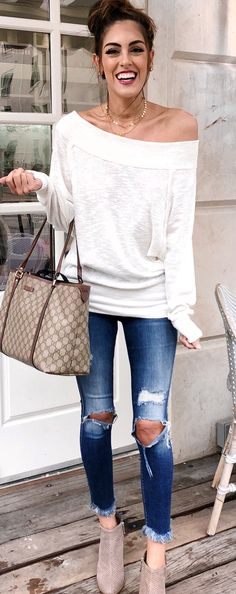 #spring #outfits woman in white off-shoulder long-sleeved top and blue distressed jeans. Pic by @stylethegirl