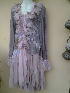 shes a gorgeous dusky brown lilac hued bohemian gypsy knit jacket kissed with pixie hemline of lace and netting,crochet inserts in the sleeves,