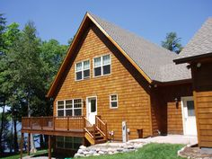 Cedar shingles were used as a siding on the exterior of this lake home. This homeowner used double hung Pella windows, and decided to use cedar on the deck as well. What a beautiful destination when heading North on vacation!
