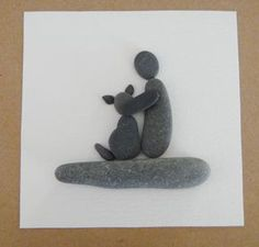 "From my love for beachcoming, I make collages from the pebbles, shell bits and sea glass I find on the Kennebunk Beach in Maine. No two are alike. Here I have created a dog with its ""parent"", availabl"