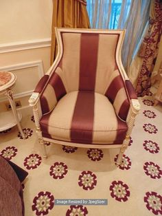 Lot 1086 - Italian Neoclassical painted and parcel gilt upholstered Bergere, upholstered in gold stripe fabrics