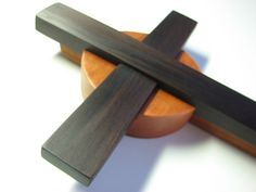 Rosewood and cherry. Top of cross vertical has slight natural edge cracking in wood. Minimally noticeable. 16 x 6.5 x 1