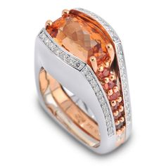 This gorgeous ring features a stunning Imperial Topaz and is accented with Natural Umba Sapphires and Round Brilliant Diamonds!