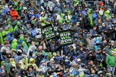 Seattle Seahawks fans watch as players warm up before an NFC divisional playoff. (Ted S. Warren/AP)