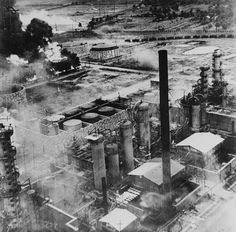 The Columbia Aquila refinery burning after a B24 raid    notice the camouflage on the buildings