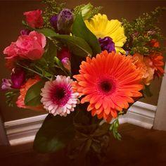 Bright & Colourful Birthday Bouquet — Pink, orange & yellow gerberas, roses, purple lisianthus & freesias and solidago © Gaïa Art Floral