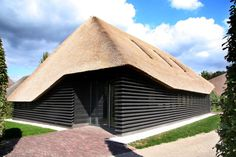 Renovated Belgium farmhouse. Thatch roof, louvers.