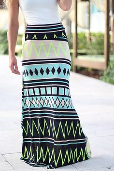 Color Pop! This super cute Mint and Neon Yellow Chevron Maxi Skirt is definitely a must have piece! We just love this fun chevron print and the fit is simply flawless! - 94% Rayon - 6% Spandex Length: