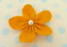 Making felt flowers is easy to do with these three simple designs and clear step-by-step instructions. Great for homemade baby gifts and decorating the home.
