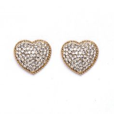 "Product Description     Sweet and sultry pave heart studs on surgical steel posts. Earring is 0.75"" wide at widest point and the glass stones are 0.25"" each. $18.99"